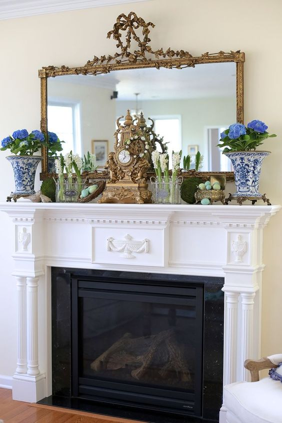potted flowers and spring bulbs, moss balls and colorful eggs in a silver sugarpot for a refined spring mantel