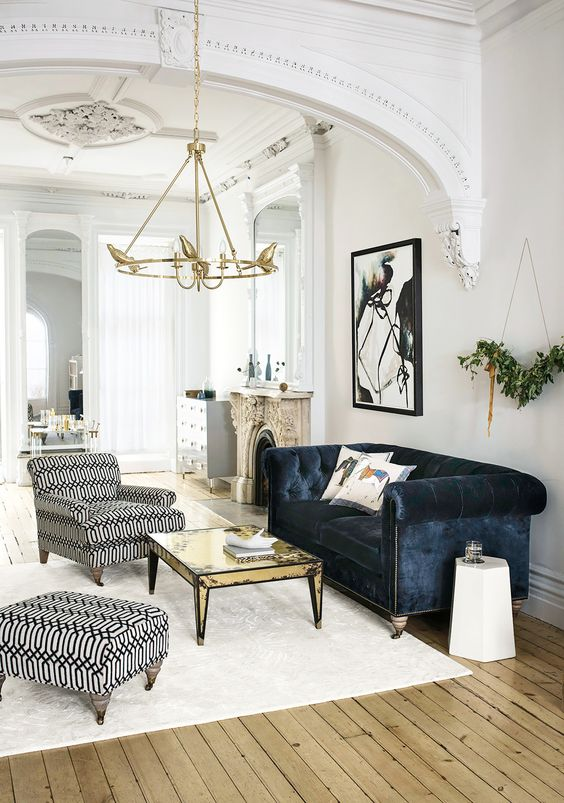 a refined space with shabby touches and a navy velvet Chesterfield sofa as a dark touch