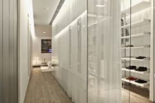 22 a stylish glass walled closet with lots of open shelves is made more private with curtains