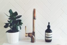 22 clad a bathroom backsplash with long and narrow tiles in a chevron pattern