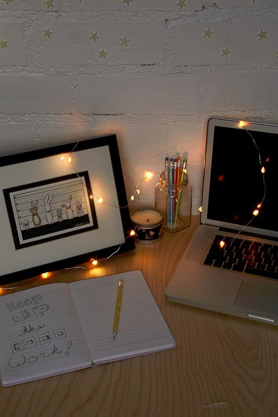 some string lights put right on teh desk to make it shine and inspire you