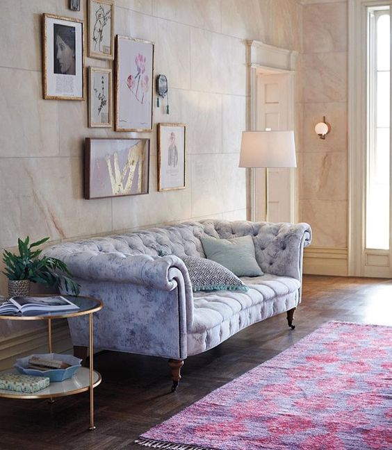 a watercolor grey and blue Chesterfield with exquisite legs and armrests