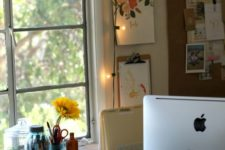 23 bring more light to your working space with string lights hanging next to it