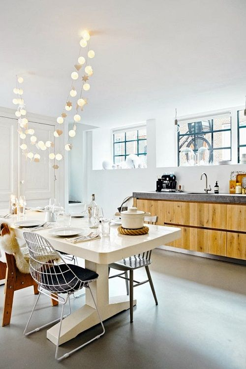 fun string lights hanging over the dining space in the kitchen to accent it