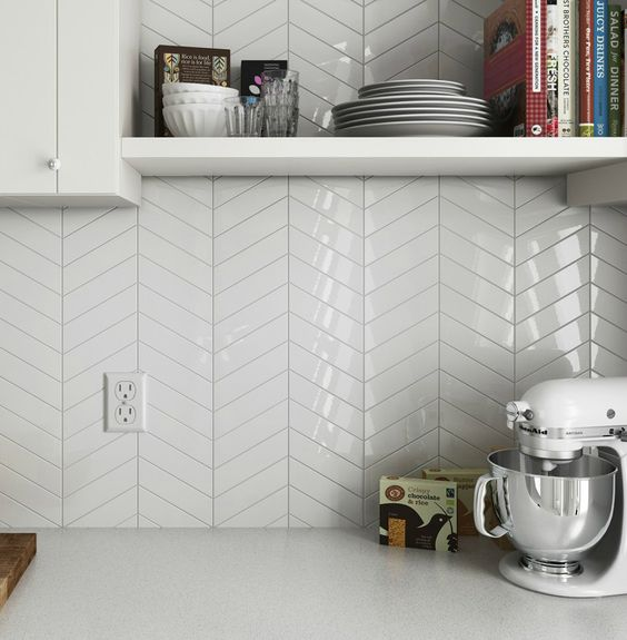 glossy white chevron tiles add an edgy geo touch to the neutral space
