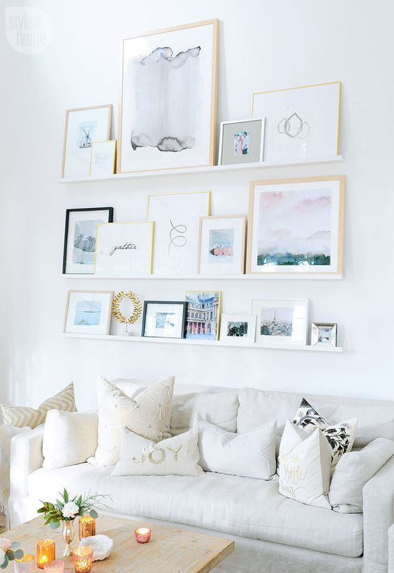 a seaside-inspired gallery wall placed on ledges to change the place and artworks easily