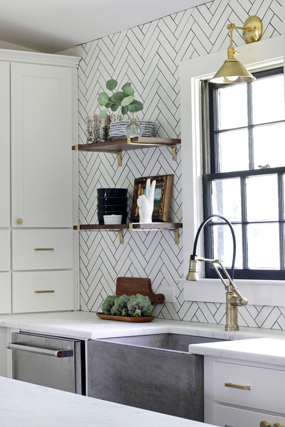 long white tiles clad in a chevron pattern and accented with black grout