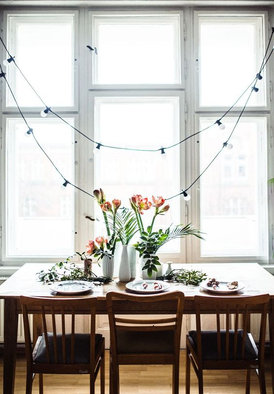 hang string lights over the dining space to separate it from the kitchen itself