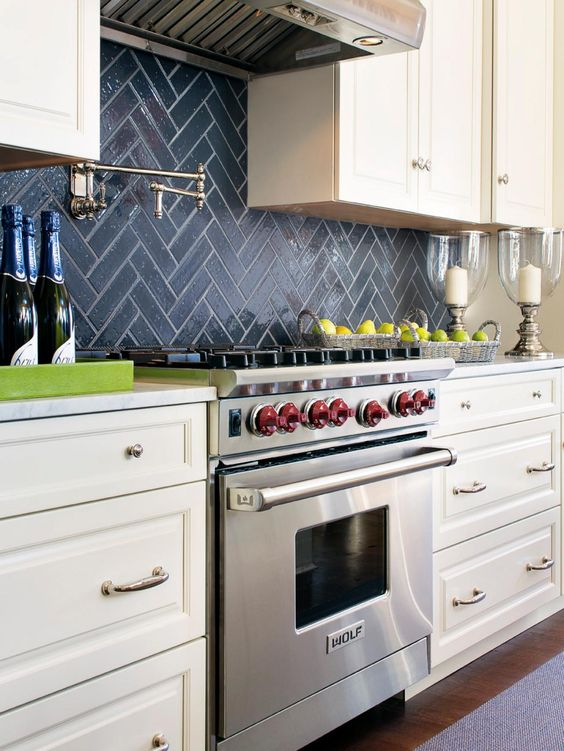Navy Chevron Tile Backsplash Stands Out In A Neutral Farmhouse Kitchen