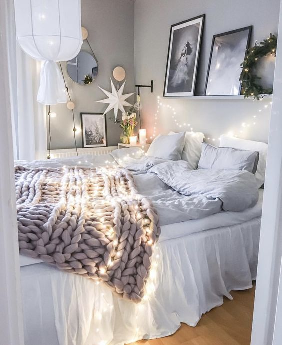 string lights over the bed and on the wall to make your sleeping space cozier