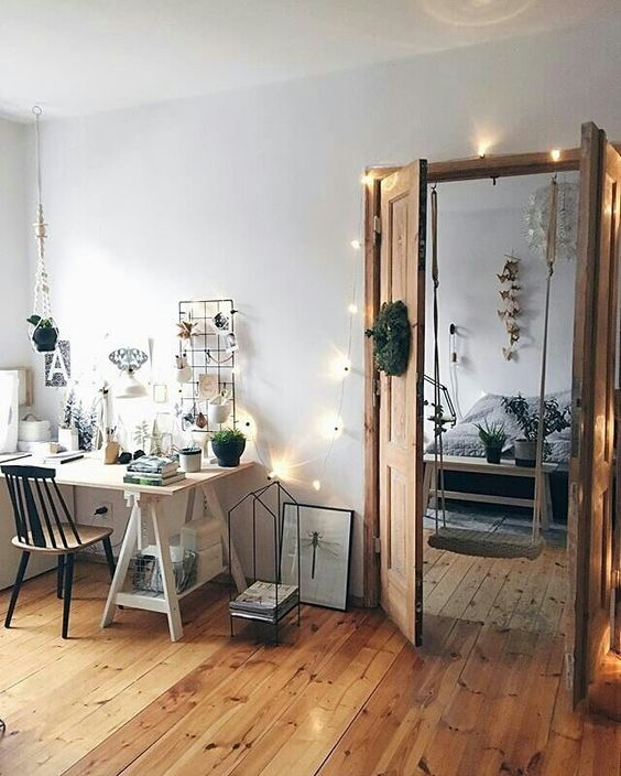string lights over the doors and on the wall add coziness to the space