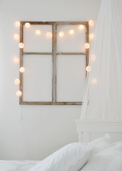 a faux window with string lights adds to the ambience and makes the space comfier