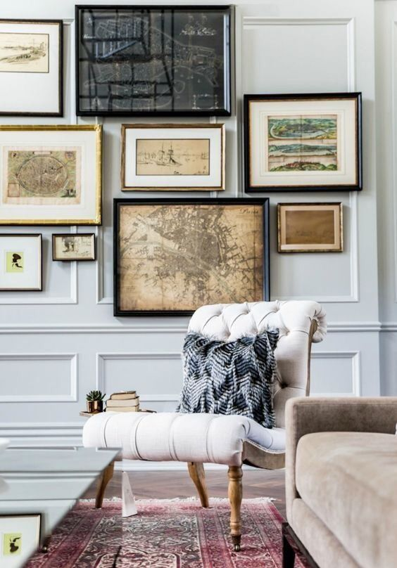 a vintage-inspired and travel-inspired gallery wall with various frames and looks
