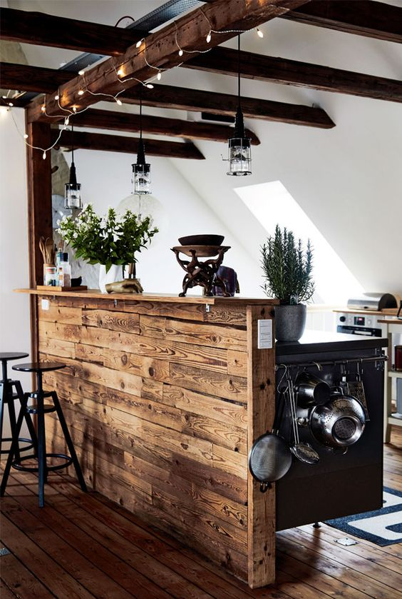 highlight your exposed beams with string lights to make the space more cheerful