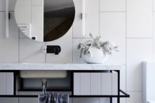 26 oversized white tiles create a wow effect in this bathroom and black grout helps to accent them