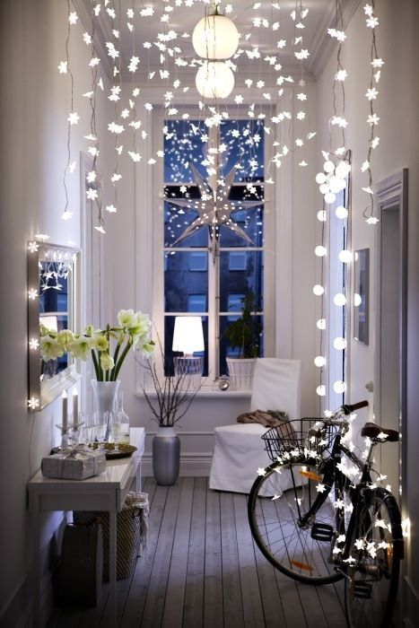 star-shaped string lights hanging from the ceiling and covering the bike for a dream ambience