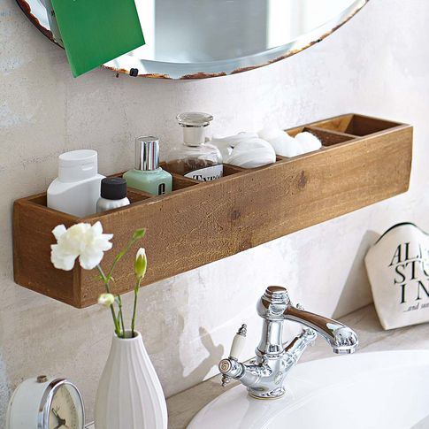 a small bathroom shelf over the sink as an organizer