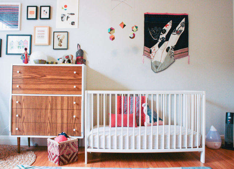 IKEA's crib looks minimalist so it fits in a nursery of any style. Even in a mid century one. (Nanette Wong)