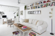 01 The living room with a home office nook is done with colorful and eclectic furniture