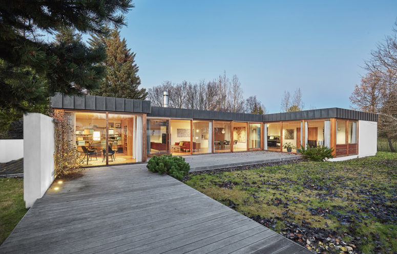 01-This-1960s-home-is-done-with-a-picturesque-roof-and-traditionally-as-a-long-one-storey-volume-with-extensive-glazing-775x497 1960s House Renovated With Impeccable Taste