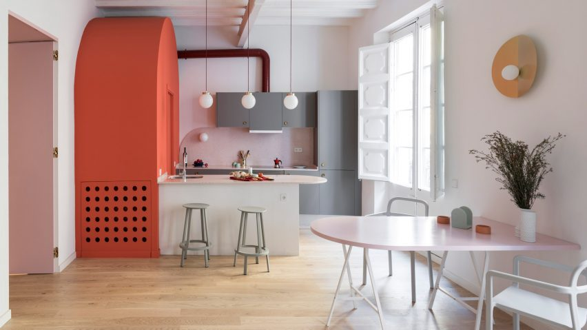 This colorful apartment is located in Barcelona and features interesting solutions and color blocking with a retro feel