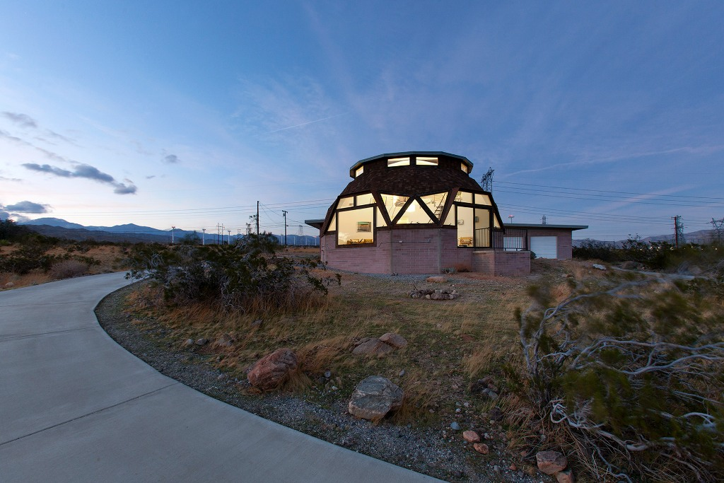 This isn't your typical mid century modern home, it features a unique dome shape and creatively shaped windows that make it special
