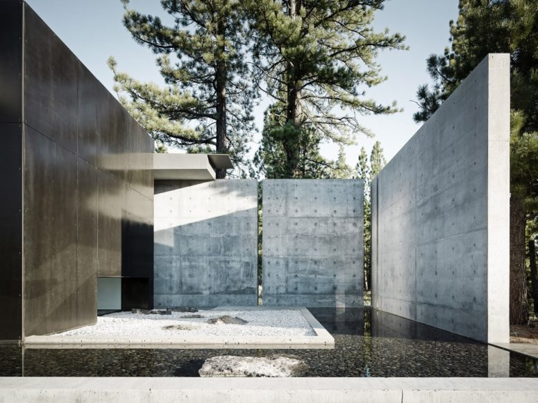 The courtyard features a rock garden with a pond filled with pebbles that is covered from two sides with metal covered walls