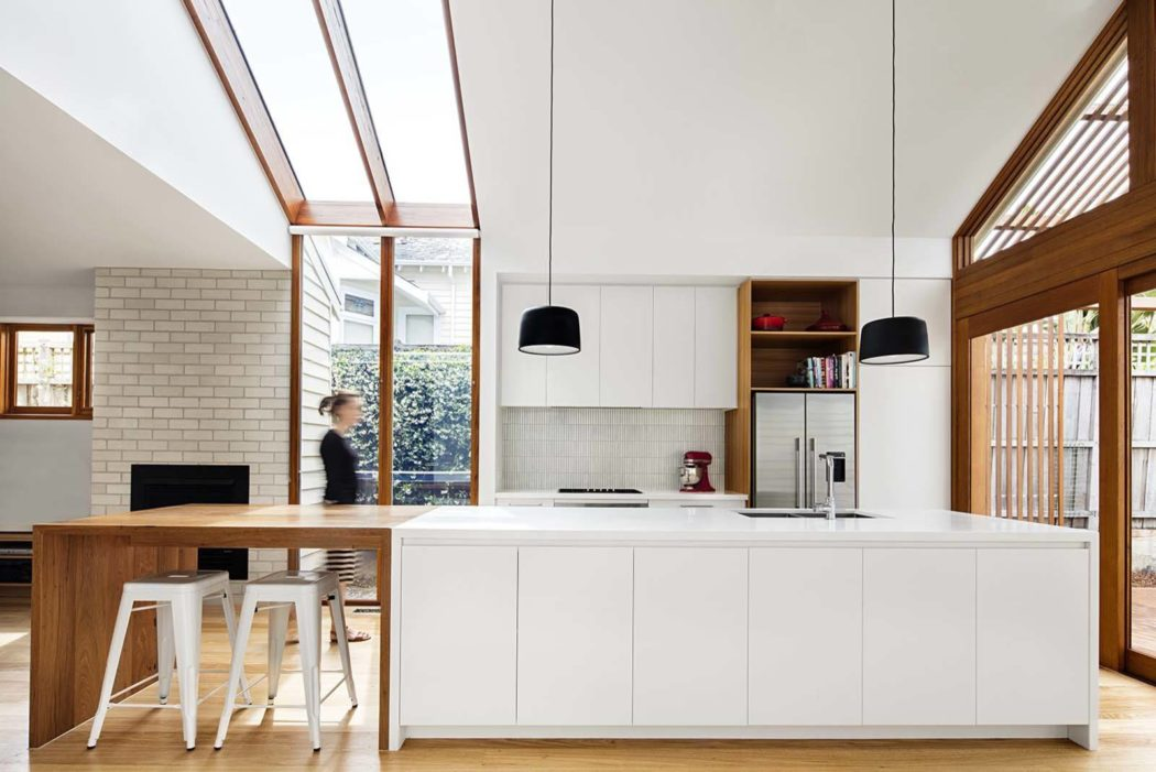 stylish white kitchen design with wooden elements