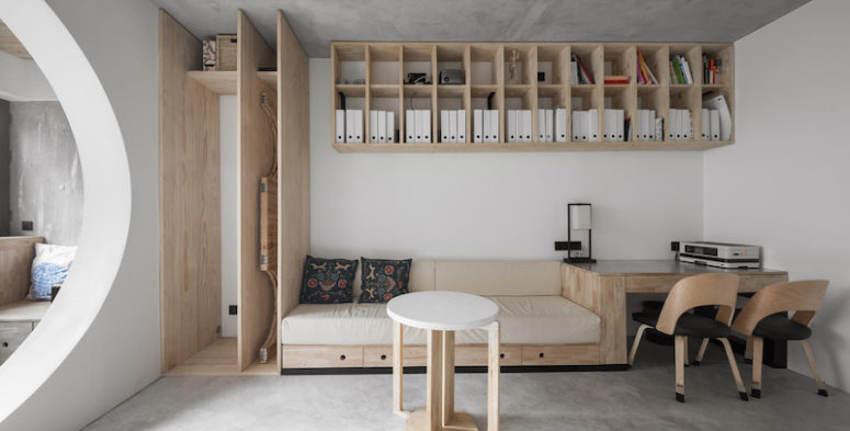 The living room features a unit that combines a sofa, desk and a storage cabinet