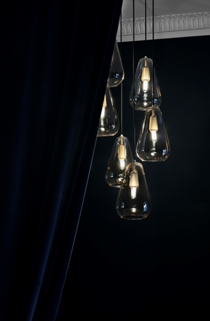 The pendants are made of metal and hand-blown glass, which is a classic combo that can fit any modern space