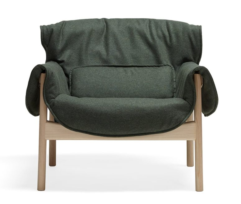 The piece is made of a reclaimed wooden frame and fabric or leather upholstery for a stylish and cozy look