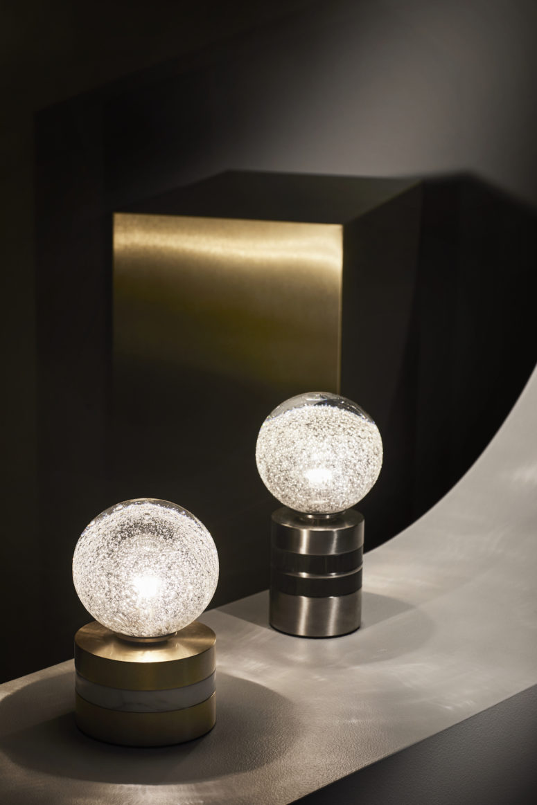 These are bubble table lamps on elegant metal stands, I almost hear this effervescence