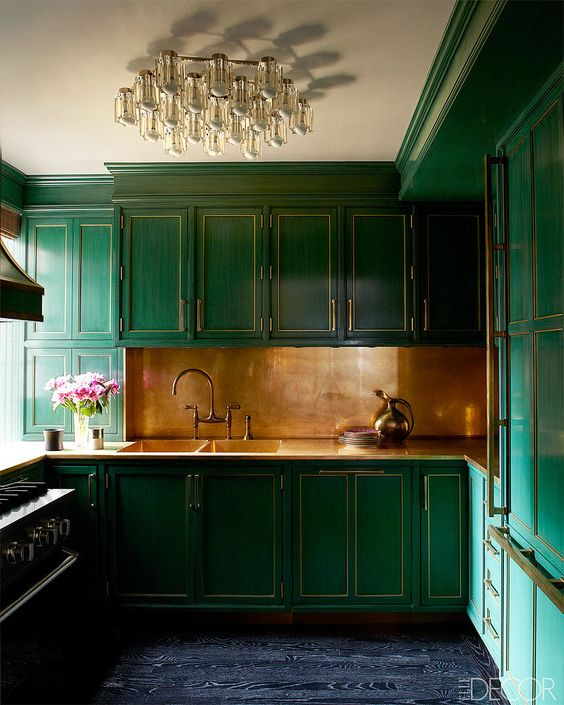 a brushed brass backsplash with art deco emerald cabinets look fantastic and very bold