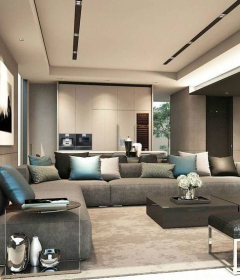 a contemporary grey L shaped sofa is a perfect piece for a large layout with a refined feel