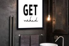 02 a fun black and white graphic artwork makes a statement in this industrial and moody space