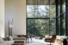 02 a light-colored wooden plank ceiling makes the minimalist space cozier and warmer