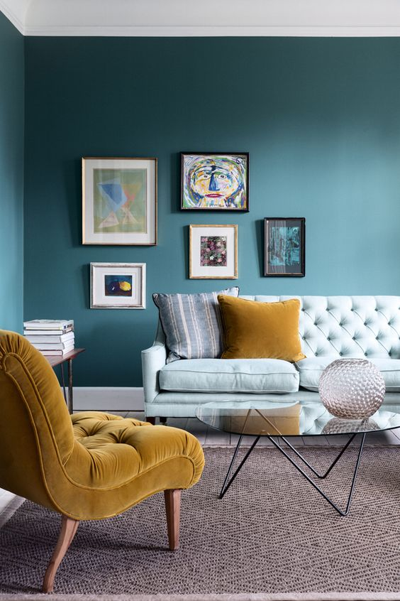 an asymmetrical colorful gallery wall makes a trendy statement in the living room