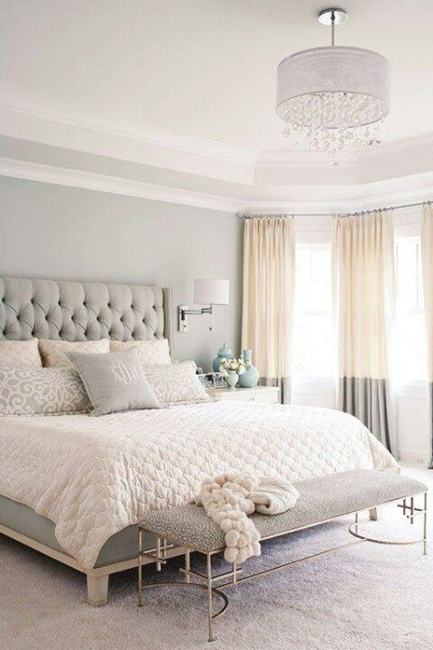color block blush and grey curtains add a tender feel to the room and highlight its glam style