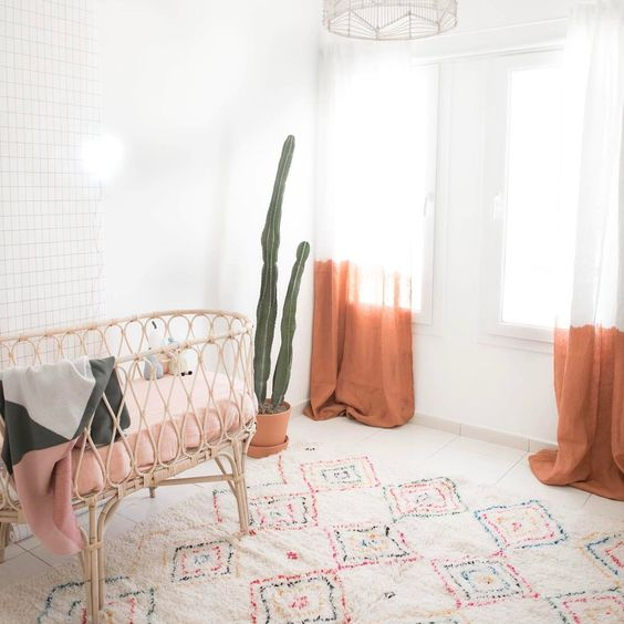ombre orange curtains are a nice idea to add a colorful touch to a nursery