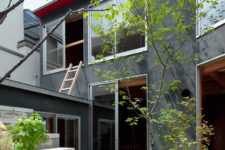 03 Greenery and rocks look very interesting in front of a modern dark grey home