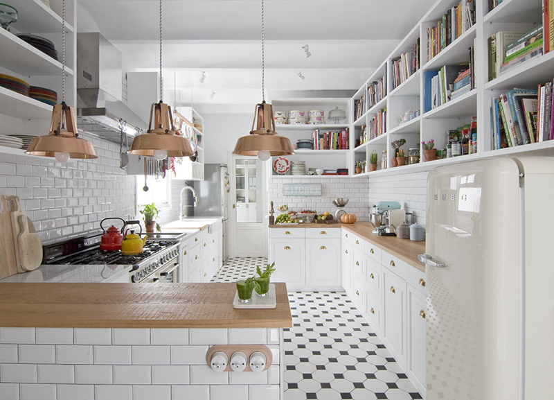 Large and long shelves take two walls, and some colorful touches enliven the kitchen