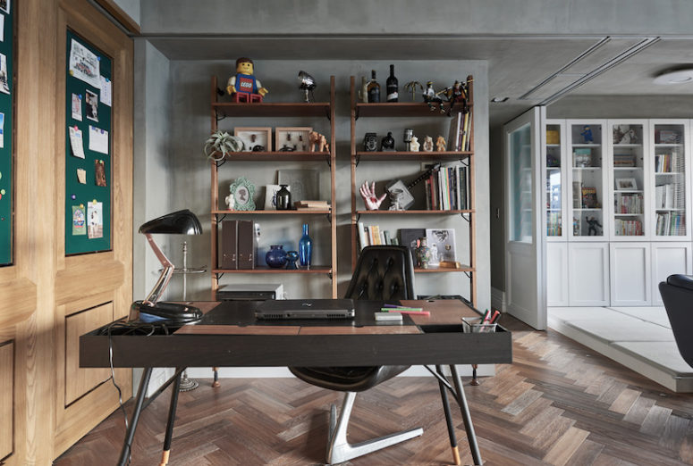 The home office space features some industrial touches and more masculine looks as this is for the husband