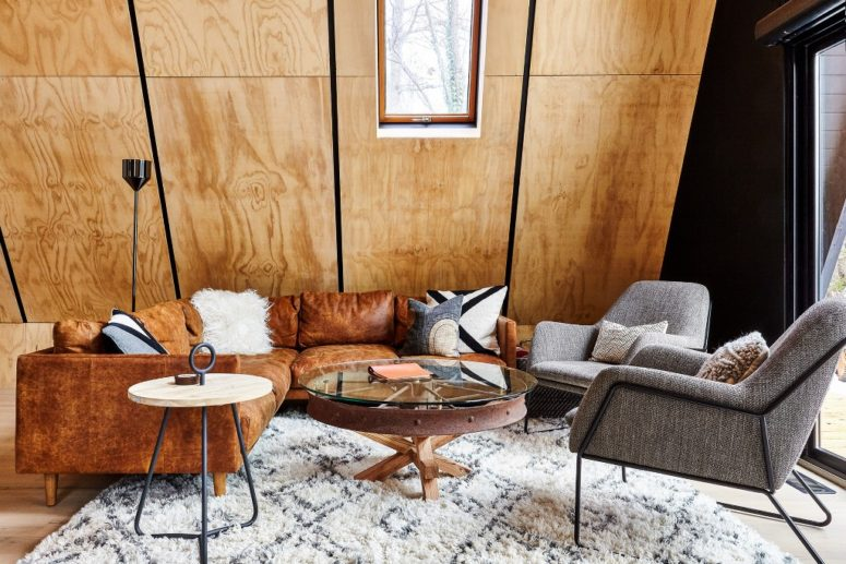 The spaces inside are covered with honey-toned plywood, which makes them cozier and warmer