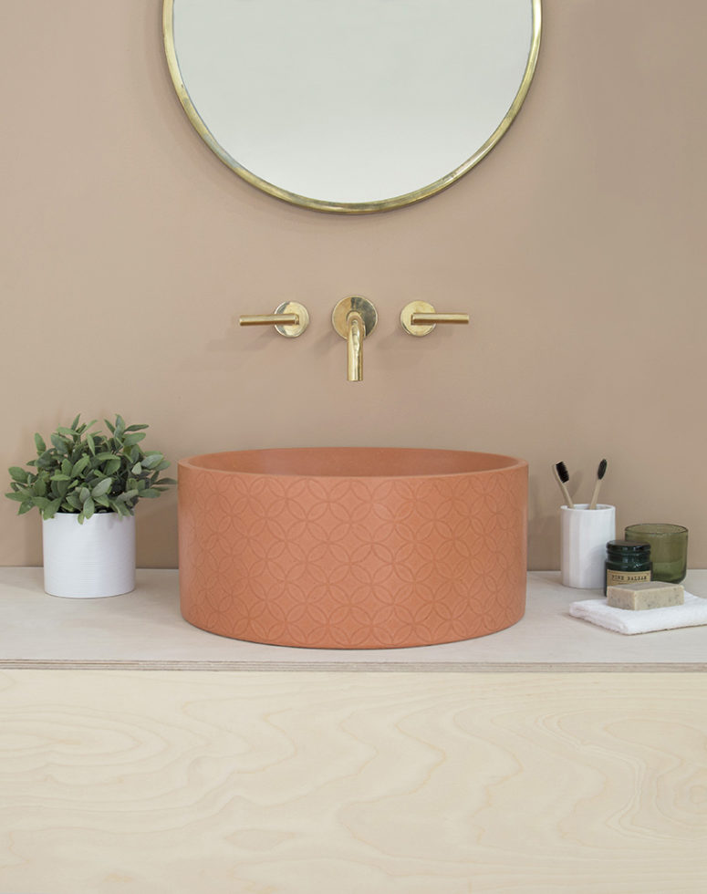 This is a rust-colored sink in the round shape and a cool print, it's a chic idea to add color to your space