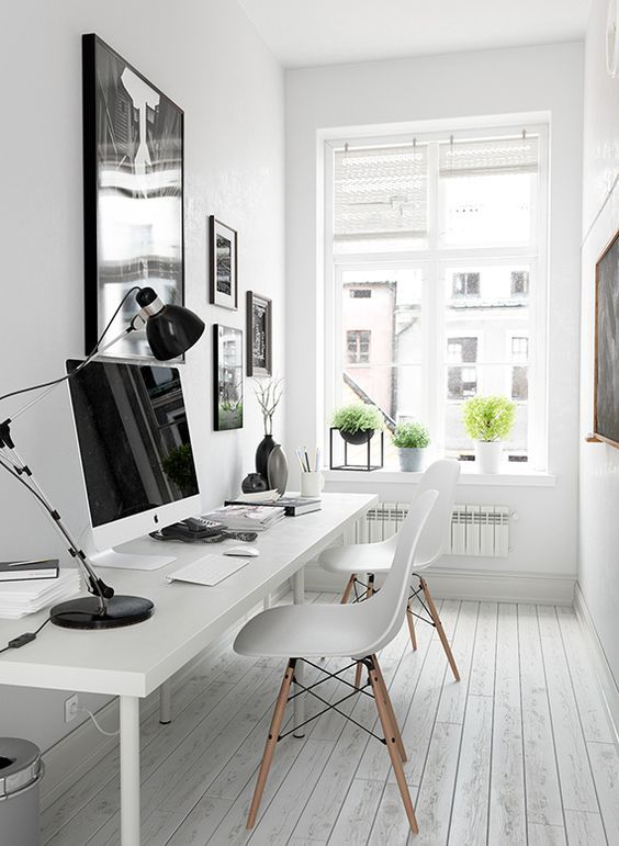 A Black And White Gallery Wall Over The Desk Gives More Style To The Space