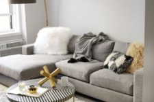 03 a comfy grey, creamy and gold living room with a large grey sectional sofa that takes half a space