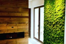 03 a fresh moss wall and a reclaimed fireplace wall bring a strong natural and relaxing fele to the space
