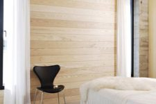03 a light-colored wooden slab ceiling and matching walls for an airy Scandinavian space