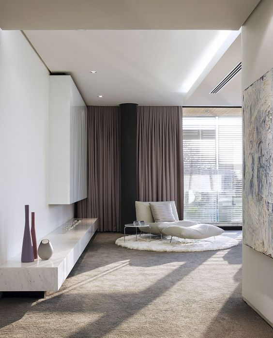 a neutral room is added color with mauve folded draperies and looks more interesting