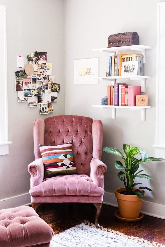 a pink tufted velvet wingback with a matching footrest is right what you need for a reading space